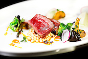 "SHOT 2/20/12 4:48:16 PM - Lamb loin with black trumpet and chanterelle mushrooms, crispy brussel sprouts, radish and cauliflower puree at TAG restaurant on Larimer Square in downtown Denver, Co. TAG is owned and operated by chef/owner Troy Guard. TAG features what they term ""continental social food"" and features influences from numerous continents. .(Photo by Marc Piscotty / © 2012)"
