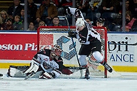 KELOWNA, CANADA - NOVEMBER 10: Tyler Benson #17 and Todd Scott #1 of the Vancouver Giants try to stop the puck from the entering the net during second period against the Kelowna Rockets on November 10, 2017 at Prospera Place in Kelowna, British Columbia, Canada.  (Photo by Marissa Baecker/Shoot the Breeze)  *** Local Caption ***