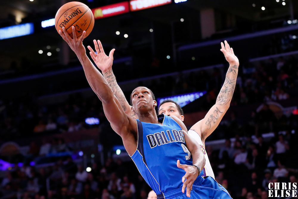 12 April 2014: Dallas Mavericks guard Rajon Rondo (9) goes for the layup past Los Angeles Lakers guard Jabari Brown (15) during the Dallas Mavericks 120-106 victory over the Los Angeles Lakers, at the Staples Center, Los Angeles, California, USA.