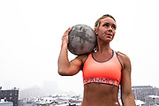 Jan 21, 2013; Baltimore, MD, USA; Shelbye Schlange a fitness model from Sports+Lifestyle Unlimited CrossFits by flipping tires and holding atlas stones outside in the snow near CrossFit Harbor East and in industrial backdrops around south east Baltimore neighborhoods of Fells Point and Canton. Mandatory Credit: Brian Schneider-www.ebrianschneider.com