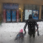 February 3, 2014 - New York, NY : Figures are seen in the snow through the window of the M60 bus in Queens, on Monday afternoon. <br /> CREDIT: Karsten Moran for The New York Times