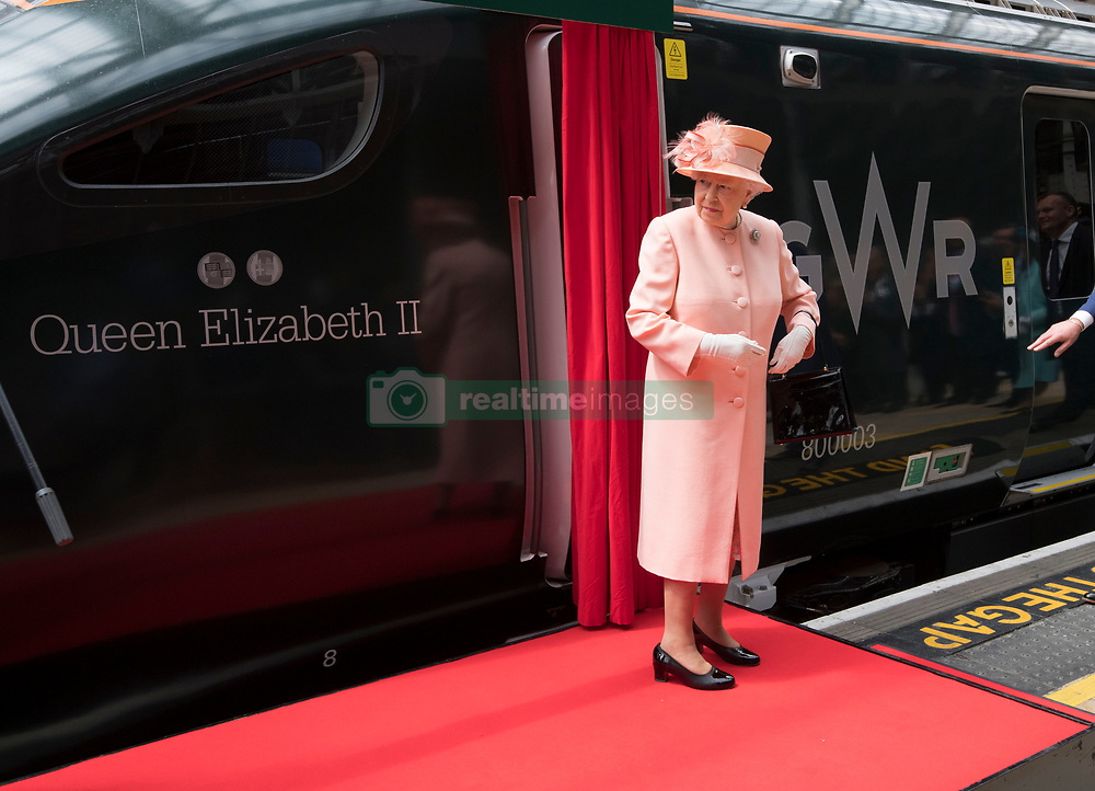 Queen Elizabeth II unveils the new livery of the train as she and the Duke of Edinburgh arrive at Paddington Station in London, as they marked the 175th anniversary of the first train journey by a British monarch.