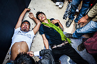 "Two young men writhe around a small room backstage at the Naga Chili Eating Competition in Nagaland, India. The Naga chili is said to be the hottest chili in the world, and apparently the affects of eating between 8-13 of them in a 20-second period doesn't exacty do wonders to your body's interior. The men are sweating and cramping and vomiting in the small backroom. After seeing their glazed expressions I asked the doctor if there was any euphoria involved and he said, ""probably not""."