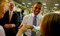 KAUKAUNA, WI - JUNE 12:Presidential candidate, Senator Barack Obama (D-Ill) center greets fans after speaking to supporters at a town hall meeting at Kaukauna High School June 12, 2008 Kaukauna Wis. During this stop in Wisconsin Barack concentrated on talking about his plans for health care and tax reform which he says are greatly different from his opponent Senator John McCain (R-Arz).  (Photo by Darren Hauck/Getty Images)