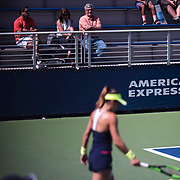 August 30, 2017 - New York, NY : Nicole Gibbs, foreground, competes against Veronica Cepede Royg (not visible) on the third day of the U.S. Open, at the USTA Billie Jean King National Tennis Center in Queens, New York, on Wednesday. Gibbs's coach Ramon Delgado is pictured at top left in red shirt. <br /> CREDIT : Karsten Moran for The New York Times