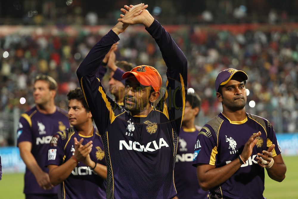 Robin Uthappa of the Kolkata Knight Riders acknowledges the crowd during the first qualifier match (QF1) of the Pepsi Indian Premier League Season 2014 between the Kings XI Punjab and the Kolkata Knight Riders held at the Eden Gardens Cricket Stadium, Kolkata, India on the 28th May  2014<br /> <br /> Photo by Ron Gaunt / IPL / SPORTZPICS<br /> <br /> <br /> <br /> Image use subject to terms and conditions which can be found here:  http://sportzpics.photoshelter.com/gallery/Pepsi-IPL-Image-terms-and-conditions/G00004VW1IVJ.gB0/C0000TScjhBM6ikg