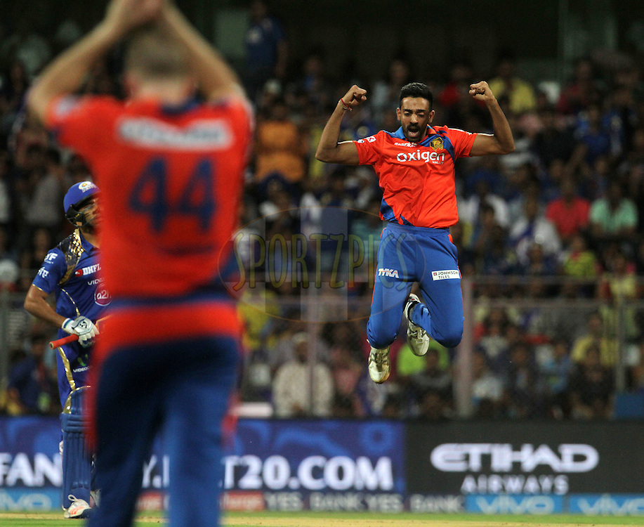 Gujarat Lions player Dhawal Kulkarni celebrates the wicket of Mumbai Indians captain Rohit Sharma during match 9 of the Vivo Indian Premier League ( IPL ) 2016 between the Mumbai Indians and the Gujarat Lions held at the Wankhede Stadium in Mumbai on the 16th April 2016<br /> <br /> Photo by Vipin Pawar/ IPL/ SPORTZPICS
