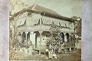 Japanese family with domestic worker in front of a very large house