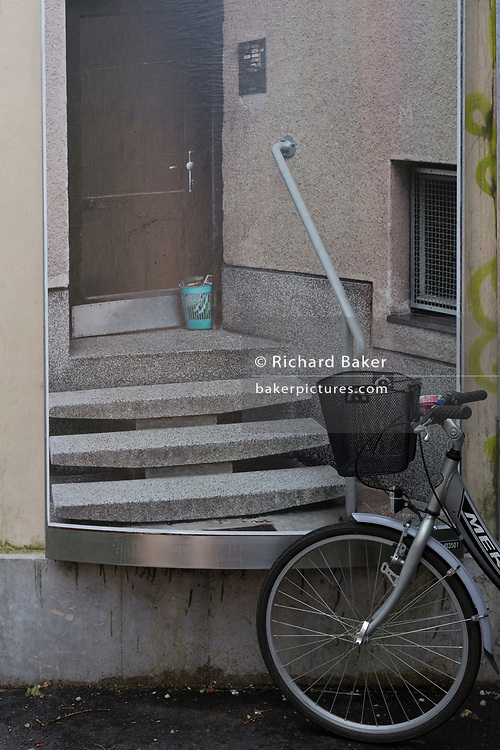 Bike and poster in the Slovenian capital, Ljubljana, on 27th June 2018, in Ljubljana, Slovenia. Ljubljana is a small city with flat terrain and a good cycling infrastructure. It was featured at eighth on the 'Copenhagenize' index listing the most bike-friendly cities in the world.