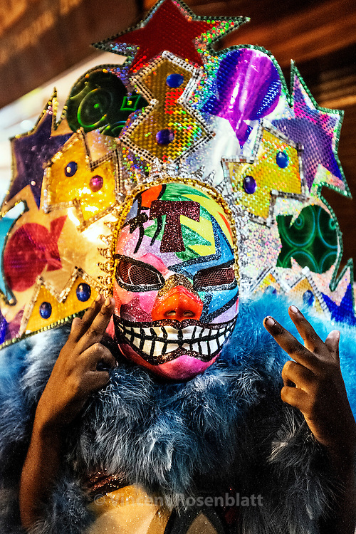 Bate-Bola kid with an unusual mask in Madureira district; zona norte of Rio de Janeiro - one of the main spot of the gangs of clowns carnival.