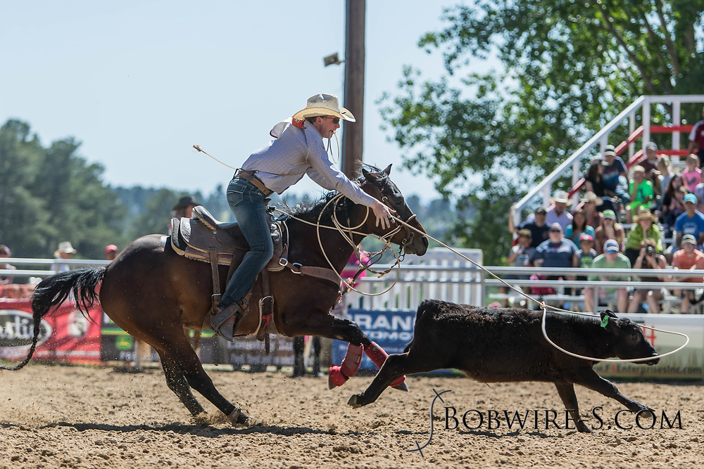Tie-down roper Jeremy Butler makes his run in the first performance of the Elizabeth Stampede on Saturday, June 2, 2018.