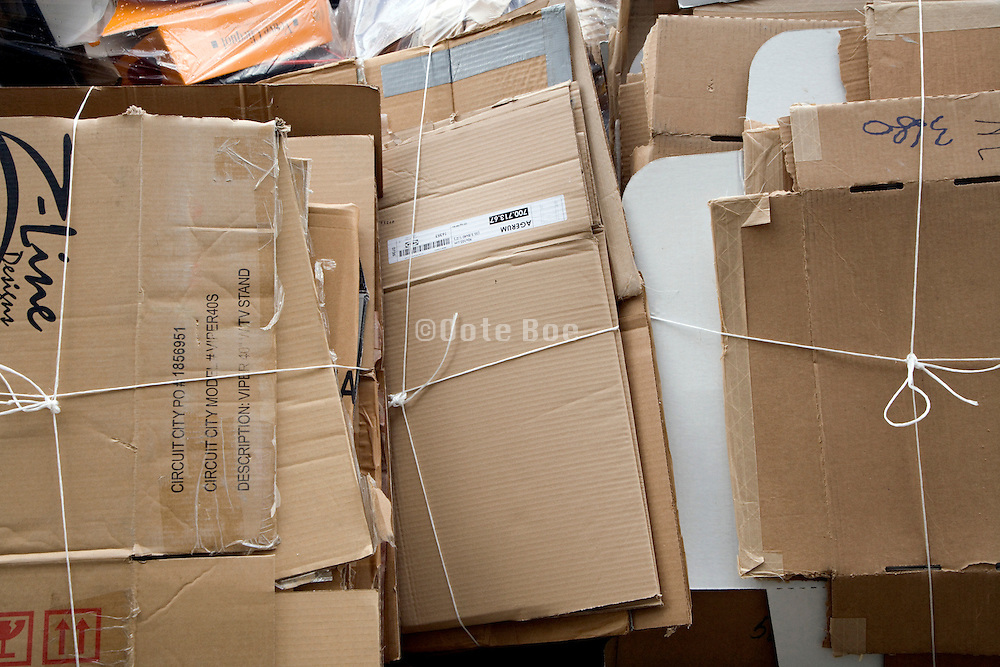paper cardboard boxes collected on the side of the street for recycling