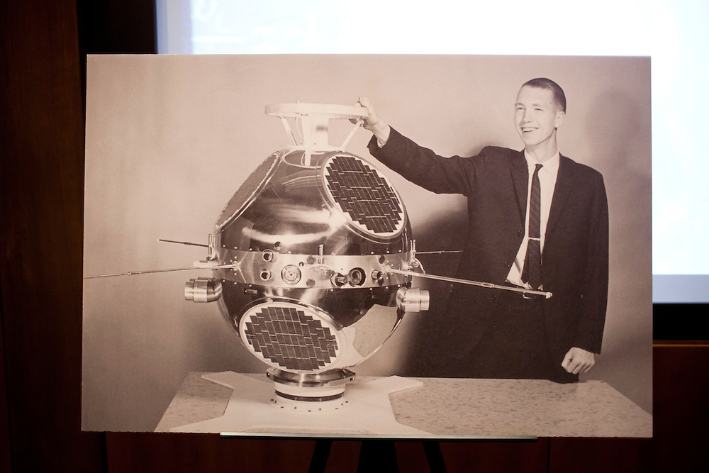 An image of Dr. Donald Gurnett with the Injun 3 satellite, built at the University of Iowa in 1962, on display at a symposium honoring the career of Dr. Donald Gurnett, professor of physics at the University of Iowa's Levitt Center for University Advancement in Iowa City on Saturday, October 17, 2015. During tests of Injun 3, Gurnett says that the first space sounds were recorded, including the whistlers he first described, which are the sound waves produced in space when lightning strikes the earth. (Rebecca F. Miller/Freelance for The Gazette)