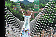 ZHANGJIAJIE, CHINA - JUNE 25:<br /> <br />  Image shows the glass-bottomed bridge receiving a safety test at Zhangjiajie Grand Canyon on June 25, 2016 in Zhangjiajie, Hunan Province of China. World\'s tallest and longest glass-bottomed bridge has been completed and took a global broadcast through television and internet medias to show its safety. More than thirty citizens and visitors thumped the bridge with hammer in the test event.<br /> ©Exclusivepix Media
