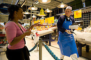 Maria Natercia Lopes-Furtado,  the mother of the Lopes-Furtado family from Cabo Verde living in Luxembourg shopping for one week's worth of food at an Auchan super market across the border in France near their home. The image is part of a collection of images and documentation for Hungry Planet 2, a continuation of work done after publication of the book project Hungry Planet: What the World Eats.