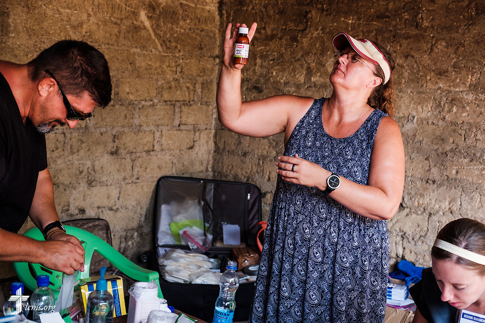The Rev. Doug and Angie Thompson, carrier missionaries to Sierra Leone, and Molly Christensen, LCMS career missionary to Togo, fill prescriptions in the pharmacy on the first day of the LCMS Mercy Medical Team on Monday, May 7, 2018, in the Yardu village outside Koidu, Sierra Leone, West Africa. LCMS Communications/Erik M. Lunsford