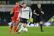 Derby County midfielder/coach Wayne Rooney  shields the ball from Fulham defender Michael Hector during the EFL Sky Bet Championship match between Derby County and Fulham at the Pride Park, Derby, England on 21 February 2020.