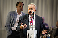 The Rev. Dr. Larry Stoterau, president of the LCMS Pacific Southwest District, speaks in favor of Resolution 3-05A from Floor Committee 3 on Sunday, July 10, 2016, at the 66th Regular Convention of The Lutheran Church–Missouri Synod. Behind Stoterau, waiting his turn to speak, is Dr. Kurt Senske, a member of the LCMS Board of Directors and chief executive officer, Upbring (formerly Lutheran Social Services of the South). LCMS/Frank Kohn