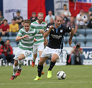 Dundee's Gary Harkins goes past  Celtic's Stefan Johansen - Dundee v Celtic SPFL Premiership at Dens Park<br />