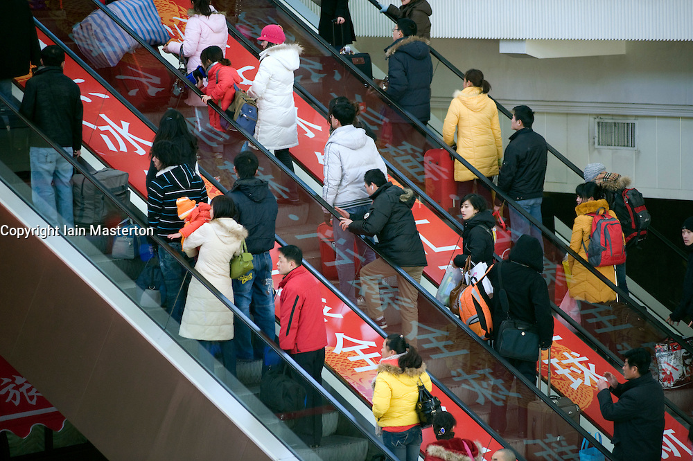 Busy escalator at Beijing Railway Station during Chinese New Year in Beijing 2009