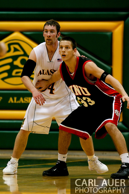 1/13/2006: Junior forward Carl Arts (34) of the UAA Seawolves defends against Kendall Gielow of the Northwest Nazarene University Crusaders as he leads Alaska Anchorage to a comeback victory over Northwest Nazarene, 60-57, in men?s basketball action at the Wells Fargo Sports Complex on Saturday.