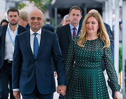 Chancellor of the Exchequer Sajid Javid arrives with wife Laura to deliver his keynote speech at the Conservative Party conference in Manchester.<br /> <br /> © Dave Johnston / EEm