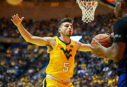 Nov 9, 2018; Morgantown, WV, USA; West Virginia Mountaineers guard Jordan McCabe (5) guards the inbound pass during the first half against the Buffalo Bulls at WVU Coliseum. Mandatory Credit: Ben Queen-USA TODAY Sports