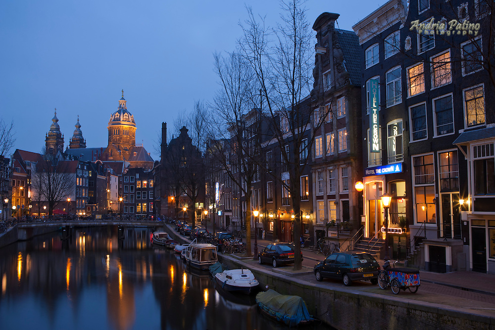 Church of St. Nicholas Reflected on oudezijds voorburgwal canal at twilight