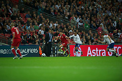 LONDON, ENGLAND - Tuesday, September 6, 2011: Wales' Gareth Bale and England's Ashley Cole under the watchful eye of England's head coach Fabio Capello during the UEFA Euro 2012 Qualifying Group G match at Wembley Stadium. (Pic by David Rawcliffe/Propaganda)