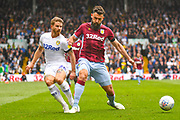 Gaetano Berardi of Leeds United (28) and Mile Jedinak of Aston Villa (15) in action during the EFL Sky Bet Championship match between Leeds United and Aston Villa at Elland Road, Leeds, England on 28 April 2019.