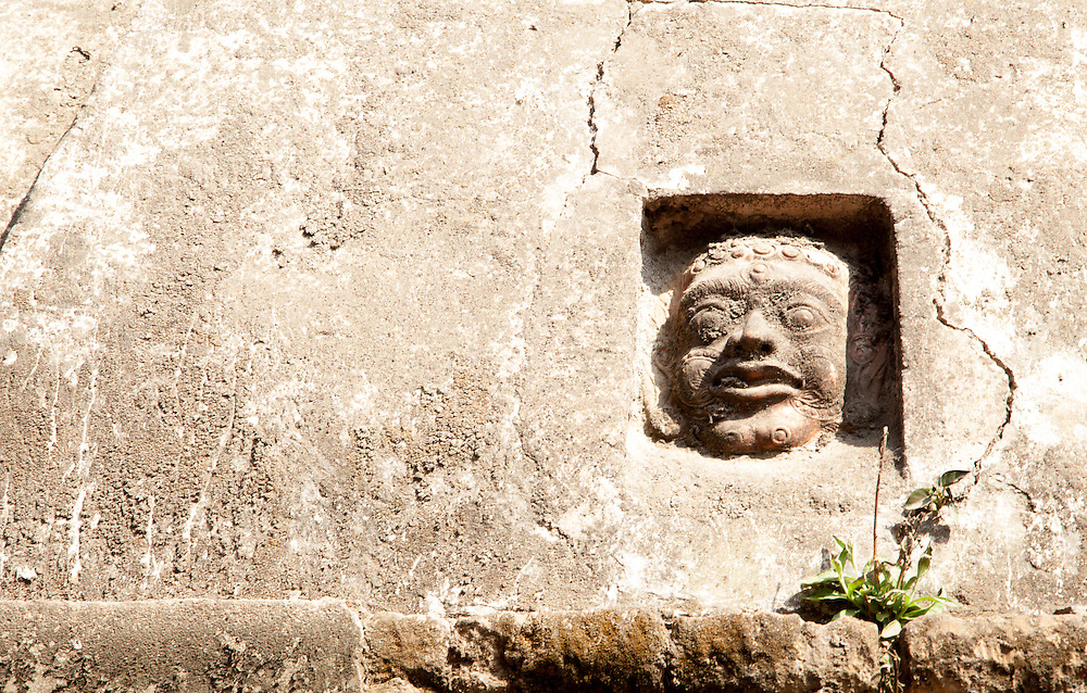 A small face detail on a temple in the medieval city of Bhaktapur in Nepal
