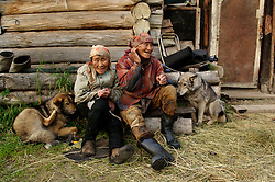Akuguk Roman Cholkovich (74) and  his wife Raisa Romanovna (79), indigenous Chukchu tribals rest after a 16 hour day of catching salmon that they filet and dry at their summer fishing camp along the river Vyvenka in Khailino, Kamchatka July 15, 2007. Most indigenous people rely on the salmon harvested in the summer for the whole year. They dry it and feed it to themselves and their dogs that they use to get around on sleds in the harsh winter months. Because the area is so remote and no longer subsidized by the Russian or Soviet government of the past goods and gasoline are extremely expensive. The economy is struggling and the only way for most people to survive is through poaching and fishing in the short summer months. So now the fish population is rapidly declining as poachers collect the eggs and don't allow the salmon to spawn for the next generations.
