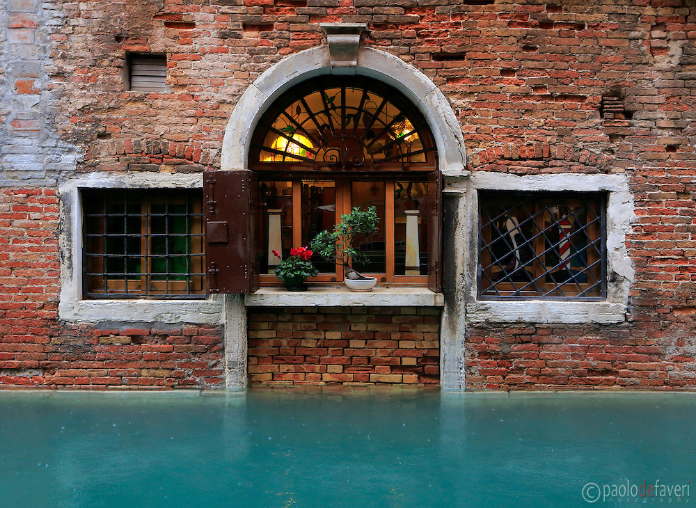 "The window of a restaurant at Rio di Vin in Venice, Italy. The exceptional high level of the water is the result of ""acqua alta"" and rain"