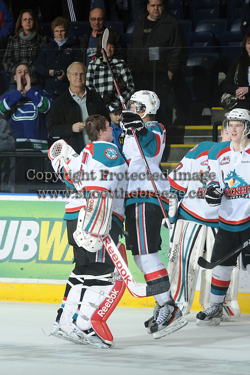 KELOWNA, CANADA - FEBRUARY 18: Adam Brown #1 and Madison Bowey #4 of the Kelowna Rockets  celebrate the win via shoot out against the  Red Deer Rebels at the Kelowna Rockets on February 18, 2012 at Prospera Place in Kelowna, British Columbia, Canada (Photo by Marissa Baecker/Shoot the Breeze) *** Local Caption ***