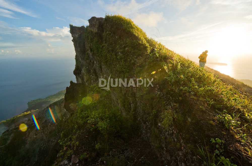 A trekker explores the crater rim at the summit of Gunung Api, the volcano that forms the heart of the Banda Islands.