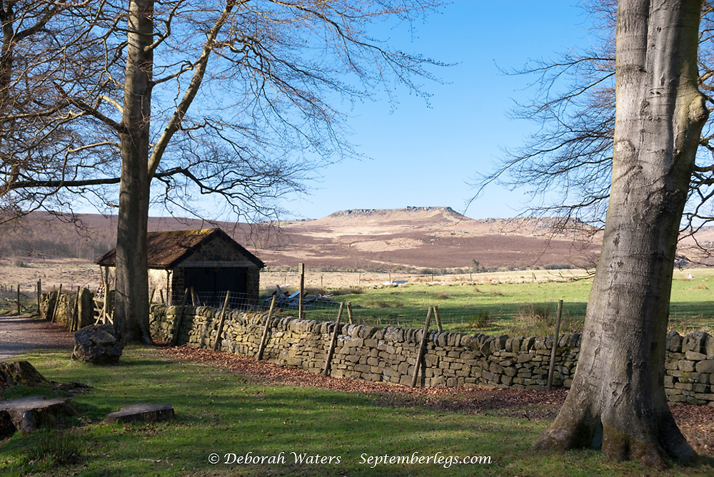 Moorland scenic : view of Carl Wark and a shepherd's hut from the Longshaw Estate, Peak District, Derbyshire, UK