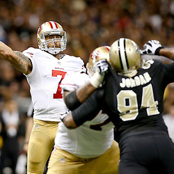 Nov 17, 2013; New Orleans, LA, USA; San Francisco 49ers quarterback Colin Kaepernick (7) throws a touchdown pass against the New Orleans Saints during the second quarter of a game at Mercedes-Benz Superdome. Mandatory Credit: Derick E. Hingle-USA TODAY Sports