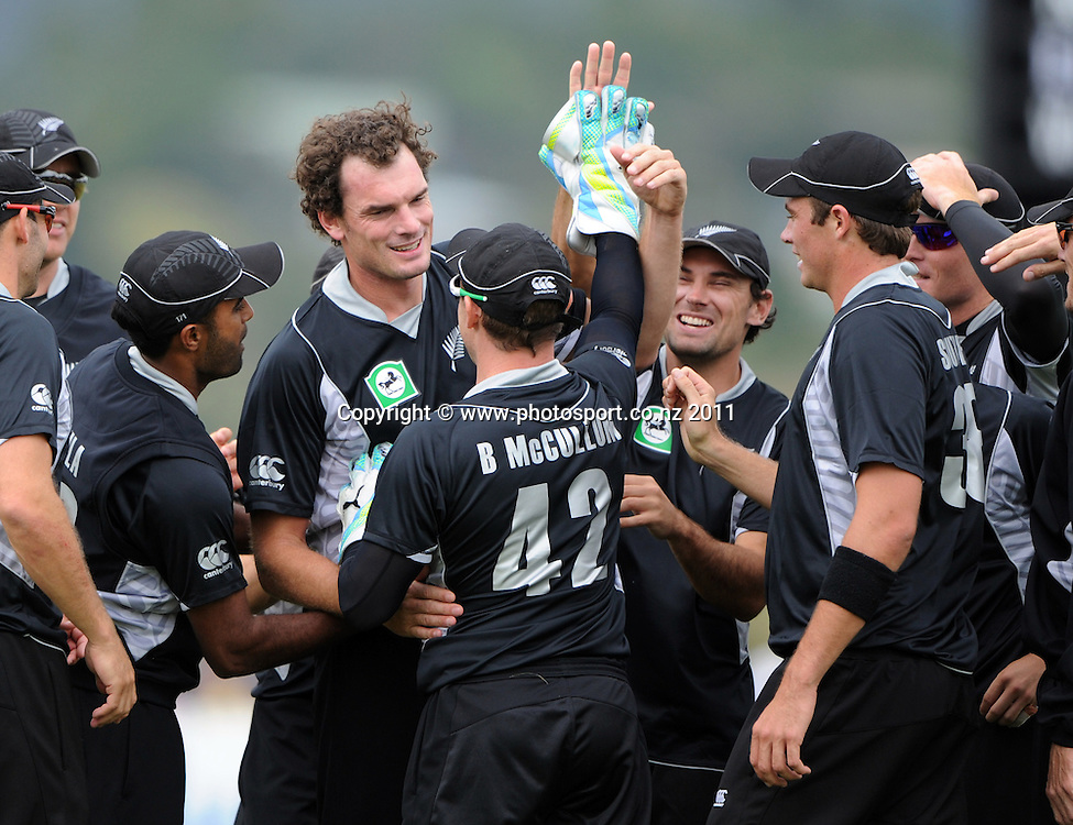 Kyle Mills celebrates with team mates after Brendon McCullum takes a catch to dismiss Zimbabwe captain Brendan Taylor during the 2nd ODI cricket match between New Zealand and Zimbabwe at Cobham Oval in Whangarei, Monday 6 February 2012. Napier, New Zealand. Photo: Andrew Cornaga/Photosport.co.nz