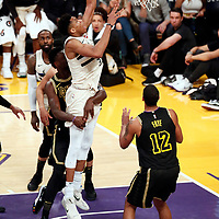 30 March 2018: Milwaukee Bucks forward Giannis Antetokounmpo (34) is fouled by Los Angeles Lakers forward Julius Randle (30) during the Milwaukee Bucks 124-122 victory over the LA Lakers, at the Staples Center, Los Angeles, California, USA.