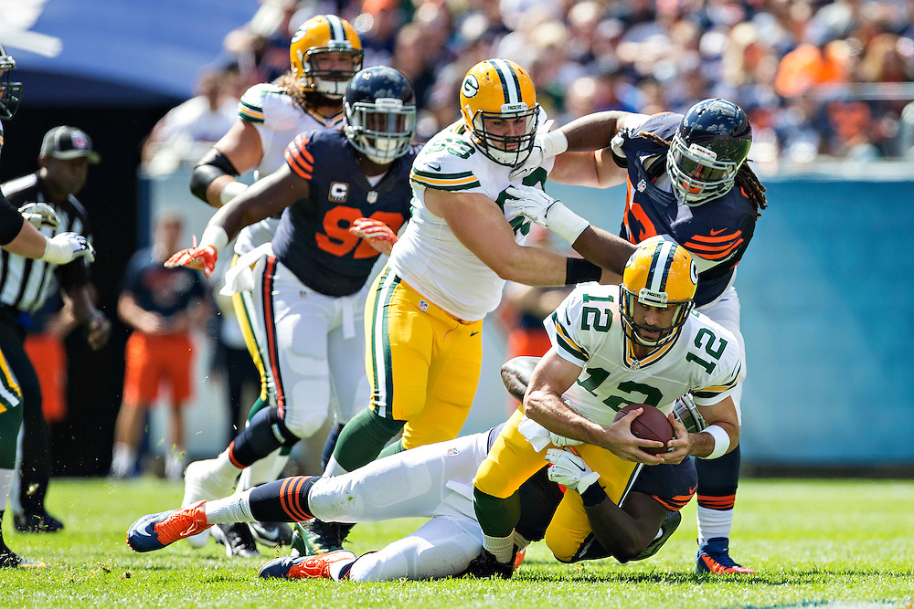 CHICAGO, IL - SEPTEMBER 13:  Aaron Rodgers #12 of the Green Bay Packers is tackled by Jarvis Jenkins #96 of the Chicago Bears at Soldier Field on September 13, 2015 in Chicago, Illinois.  The Packers defeated the Bears 31-23.  (Photo by Wesley Hitt/Getty Images) *** Local Caption *** Aaron Rodgers; Jarvis Jenkins