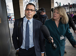 © Licensed to London News Pictures. 06/02/2018. London, UK. Zafar Khan, a former finance director of Carillion, is questioned by reporters as he leaves Portcullis House in London where former bosses of the collapsed firm gave evidence to a Business, Energy and Industrial Strategy Committee and the Work and Pensions Committe. Carillion plc, a major government contractor, went in to administration in January 2018. Photo credit: Peter Macdiarmid/LNP