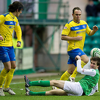 Hibs v St Johnstone...21.01.12<br /> Callum Booth is knocked to the ground after colliding with Lee Croft<br /> Picture by Graeme Hart.<br /> Copyright Perthshire Picture Agency<br /> Tel: 01738 623350  Mobile: 07990 594431