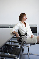 Business woman sitting beside conference table