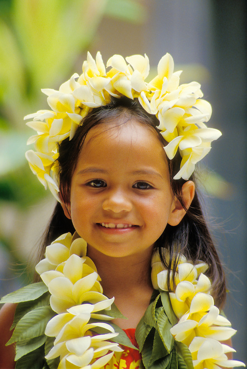 Meialohamailani Underwood with yellow plumeria leis, Prince Kuhio Day celebration hula performer, Keauhou, Kona, Island of Hawaii.