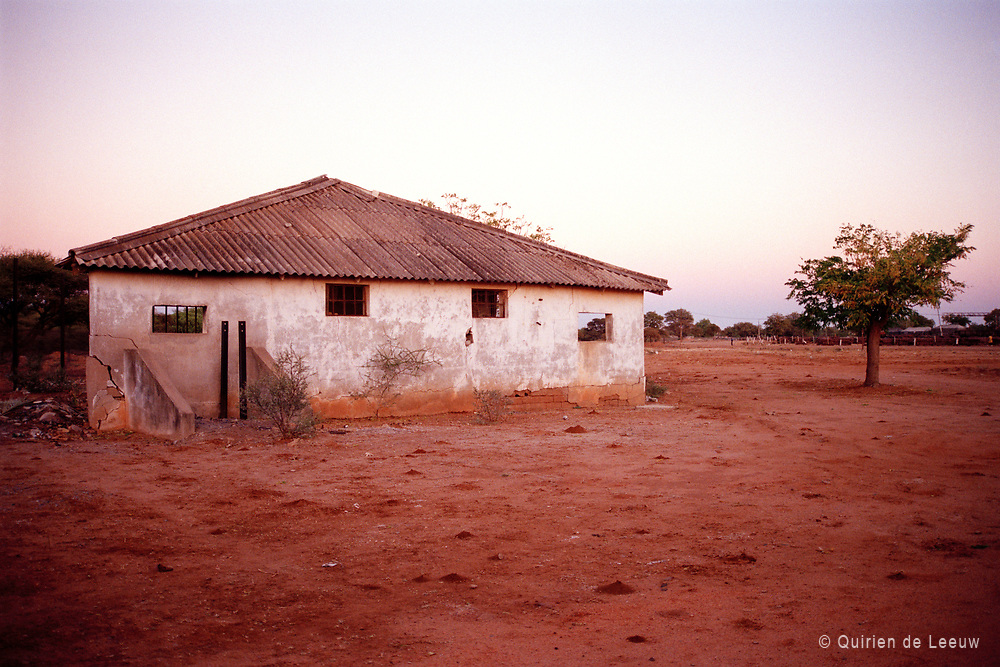A desolate house on red soil in Zambia, Southern Africa
