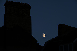 © Licensed to London News Pictures. <br /> 01/08/2017. <br /> Saltburn by the Sea, UK.  <br /> <br /> The moon rises between chimney stacks in Saltburn by the Sea.<br />   <br /> Photo credit: Ian Forsyth/LNP