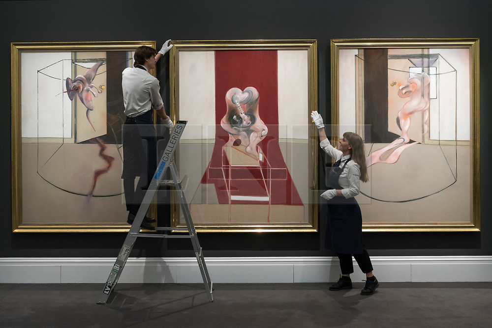 """© Licensed to London News Pictures. 06/03/2020. LONDON, UK.  Francis Bacon's monumental work """"Triptych Inspired by the Oresteia of Aeschylus"""" is presented at Sotheby's New Bond Street.  With an estimate of USD60m, the painting forms the highlight of Sotheby's Contemporary Art Sale on May 13th in New York.  Photo credit: Stephen Chung/LNP"""