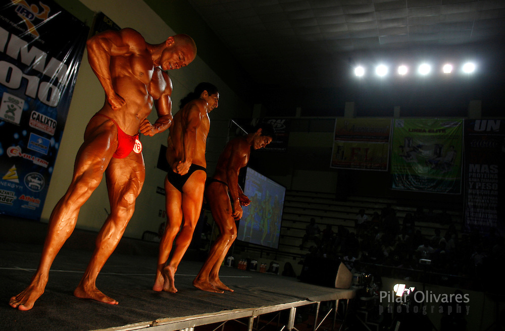 Competitors participate in a bodybuilding competition in Lima January 30, 2010.
