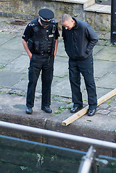 "© Licensed to London News Pictures . Manchester , UK . FILE PICTURE DATED  06/10/2013 of police waiting as the lock is drained , to recover a body . Police pulled a body from The Bridgewater Canal in Manchester , adjacent to the City's "" Gay Village "" on Canal Street . Greater Manchester Police have issued a statement after suggestions that a number of deaths in and around Manchester's canals may be linked to a serial killer , named in local folklore as "" The Pusher "" . The statement said "" Absolutely no evidence whatsoever of foul play has been established "" . Photo credit : Joel Goodman/LNP"