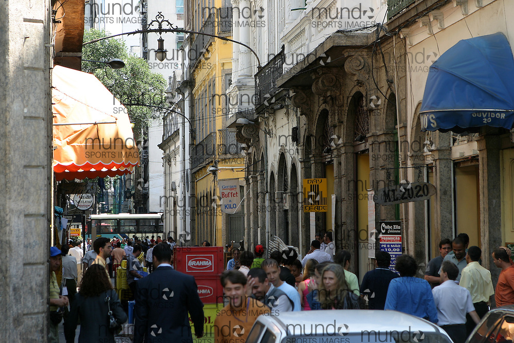 A view down a street in the old part of central Rio de Janeiro. The area is marked by architecture from the colonial and Art Nouveau period of the city.